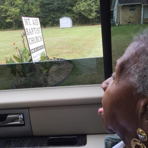 Mamie looking out window