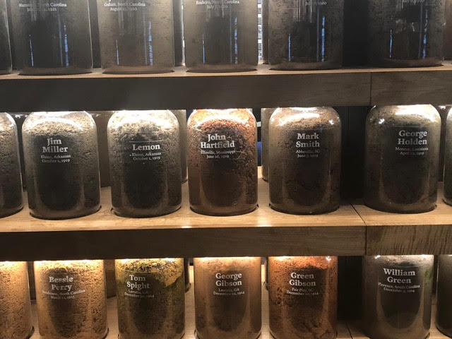 Jars commemorating lynching victims at the Legacy Museum